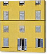 Windows Of Florence Against A Faded Yellow Plaster Wall Canvas Print