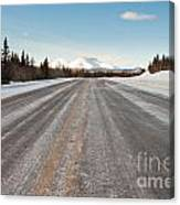 Winter On Country Road In Taiga And Snowy Mountain Canvas Print
