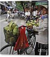 Woman Carrying Fruit On Bike Canvas Print