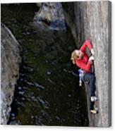 Woman Climbing Above A River Canvas Print