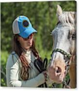 Woman Pets A Horse Canvas Print