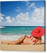 Woman Sitting On The Beach Canvas Print