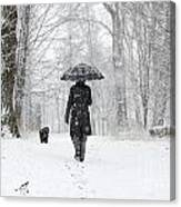 Woman Walking In A Snowy Forest Canvas Print