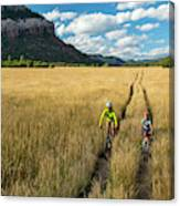 Woman With Daughter Riding Mountain Canvas Print