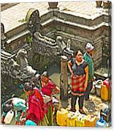 Women Get Bagmati River Holy Water From Ornate Fountains In Patan Durbar Square In Lalitpur-nepal  Canvas Print