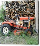 Wood Pile And Lawn Tractor Canvas Print