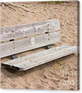 Wooden Bench Burried In The Sand Canvas Print