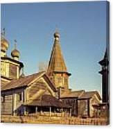 Wooden Church Complex. Old Film Camera. Canvas Print