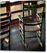 Wooden Rocking Chairs On A Deck Canvas Print