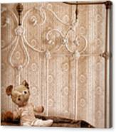Worn Teddy Bear On Brass Bed Canvas Print