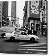 yellow cab taxi blurs past pedestrian waiting at crosswalk on Broadway outside macys new york usa Canvas Print