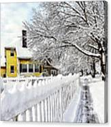 Yellow House With Snow Covered Picket Fence Canvas Print