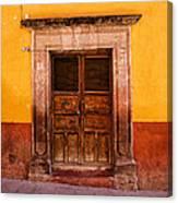 Yellow Wall Wooden Door Canvas Print