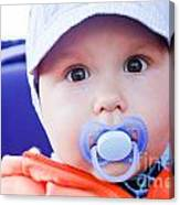Young Baby Boy With A Dummy In His Mouth Outdoors Canvas Print