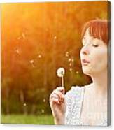 Young Beautiful Woman Blowing A Dandelion In Spring Scenery Canvas Print