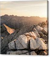 Young Man Scrambles To The Summit Canvas Print