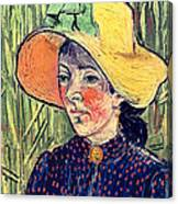 Young Peasant Girl In A Straw Hat Sitting In Front Of A Wheatfield Canvas Print