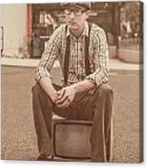 Young Vintage Man Seated On Old Tv Canvas Print