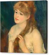 Young Woman Braiding Her Hair Canvas Print