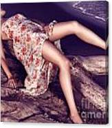 Young Woman In Dress Lying On Driftwood On A Shore Canvas Print