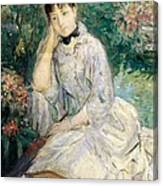 Young Woman Seated On A Sofa Canvas Print