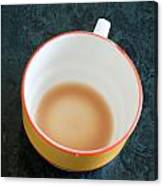 A Cup With The Remains Of Tea On A Green Table Canvas Print