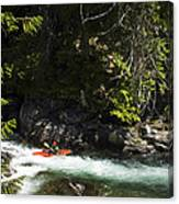 A Kayaker Paddles In A Rapid As Seen Canvas Print