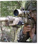 A Sniper Sights In On A Target Canvas Print