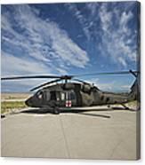 A Uh-60l Blackhawk Parked On Its Pad Canvas Print