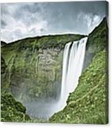 A Waterfall Over A Grassy Cliff Canvas Print