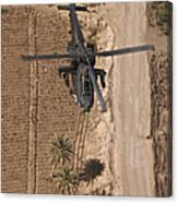 An Ah-64d Apache Helicopter In Flight Canvas Print