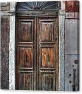 an old wooden door in Italy Canvas Print