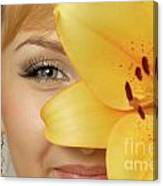 Beautiful Young Woman With A Yellow Lily Canvas Print