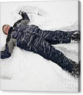 Boy And Snow Angel Canvas Print