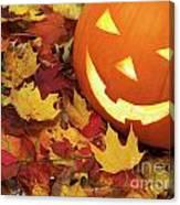 Carved Pumpkin On Fallen Leaves Canvas Print