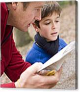 Father And Son Reading A Map Canvas Print