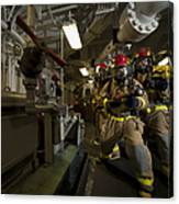 Firemen Combat A Simulated Fire Aboard Canvas Print