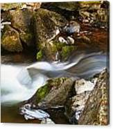 Flowing River Blurred Through Rocks Canvas Print