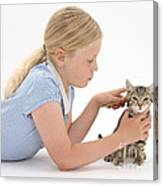 Girl Grooming Kitten Canvas Print