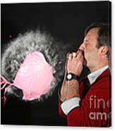 Man Over Inflating A Balloon Canvas Print