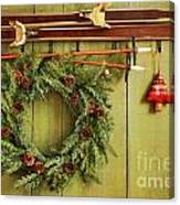 Old Pair Of Skis Hanging With Wreath Canvas Print