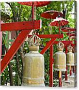 Row Of Bells In A Temple Covered By Red Umbrella Canvas Print