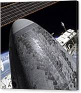 Space Shuttle Discovery Docked Canvas Print