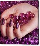 Woman Hand With Purple Nail Polish On Candy Canvas Print