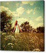 Young Girl Walking In Field Of Flowers Canvas Print