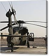 A Uh-60 Black Hawk Helicopter Parked Canvas Print