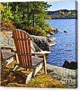 Adirondack Chairs At Lake Shore Canvas Print