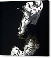 An Astronaut Anchored To A Mobile Foot Canvas Print