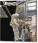 Astronauts Working On The Hubble Space Canvas Print