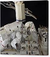 Astronauts Working On The International Canvas Print